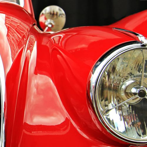 Canva - Headlight of a Classic Red Car